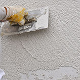 plastering a wall with lightweight insulating perlite plaster
